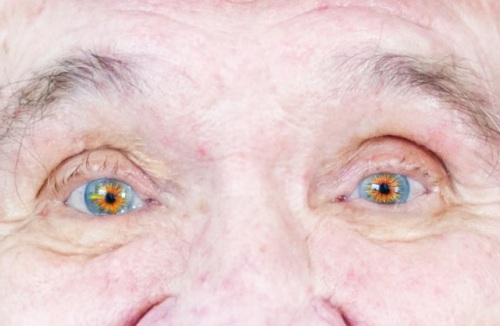 old man eyes with fire_2