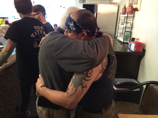 Joe and the Tattooed Guy Hug